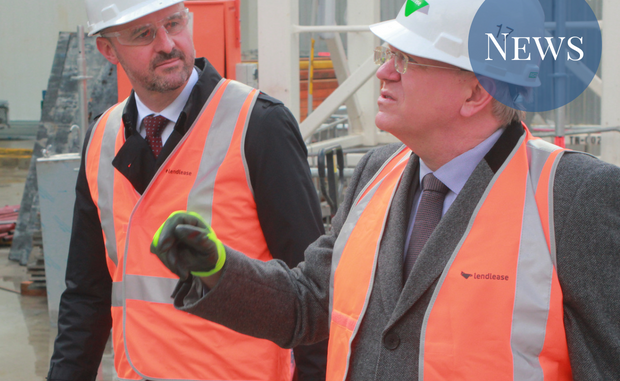 Brian Schmidt talking to Andrew Barr, both wearing hardhats and high vis vests