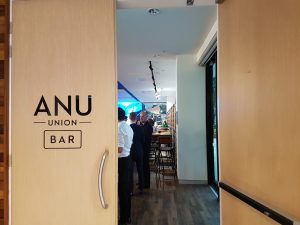 A partly open door to the ANU Union Bar