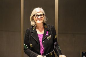 Photograph of guest speaker Dr Sam Mostyn, looking into camera and smiling
