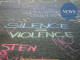 "Chalk on bitumen saying ""silence=violence"""