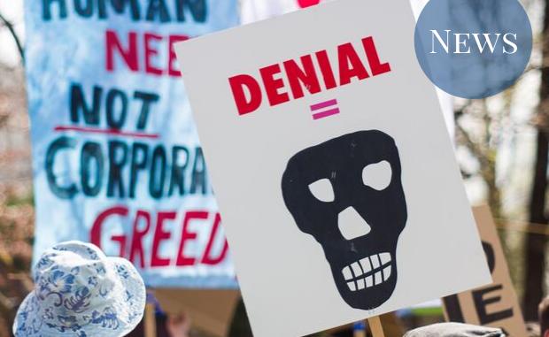 "A sign saying ""denial = [skull]"""